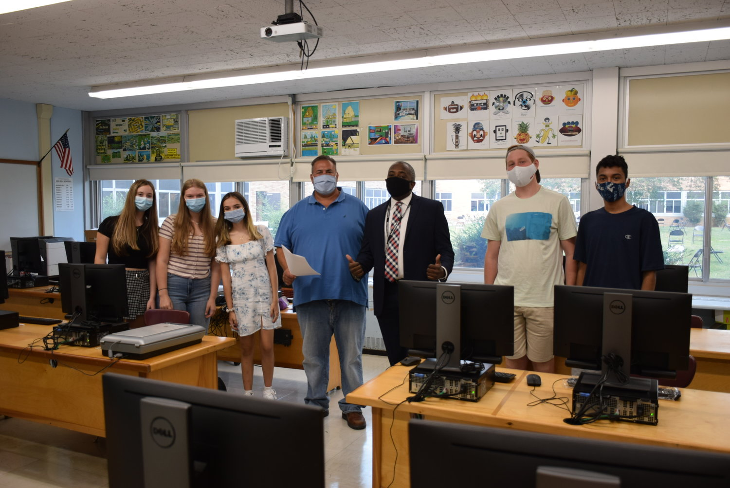 Superintendent Kenneth Card Jr. visited Samuel Joseph's multimedia class at East Meadow High School during their first day of school on Sept. 8.