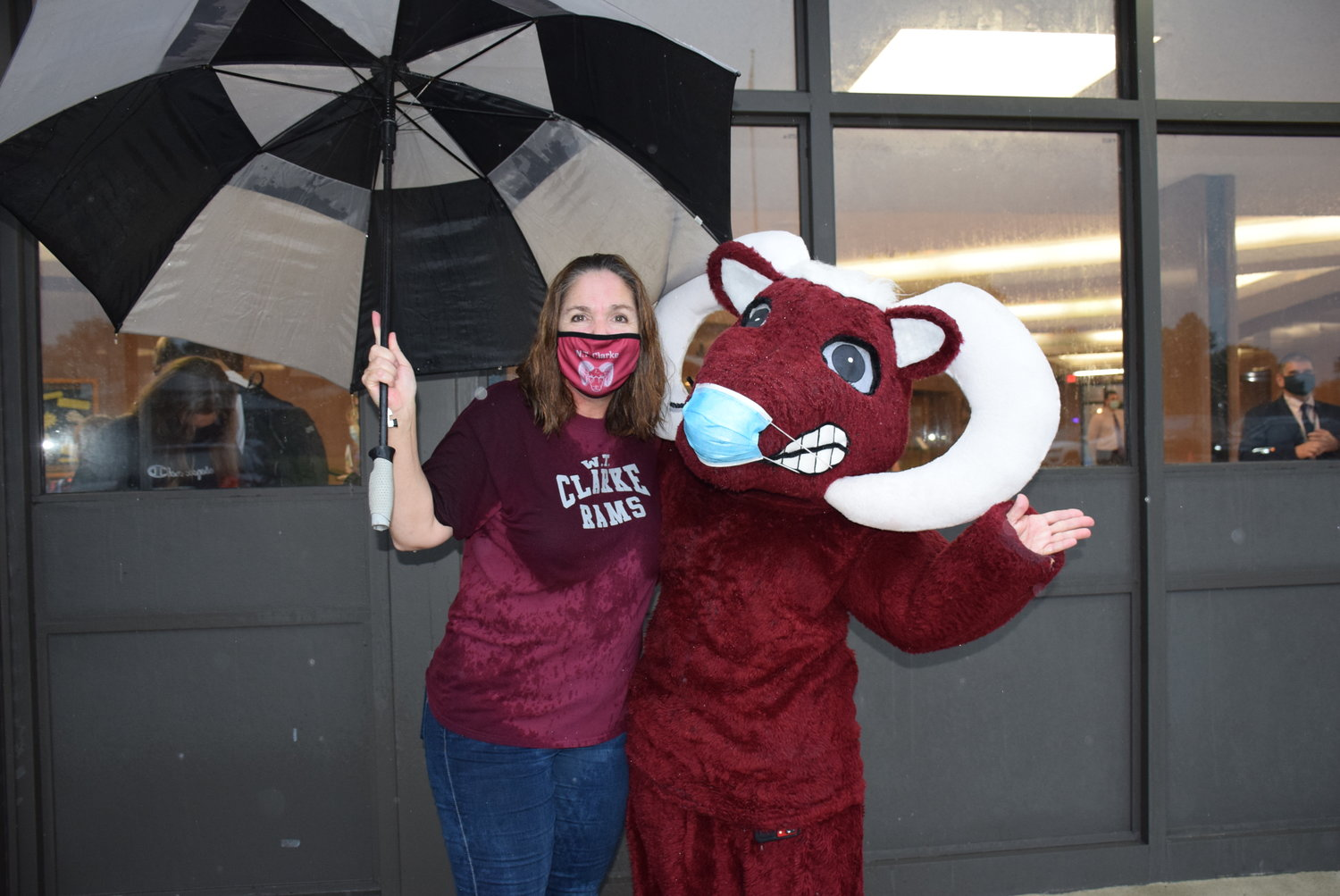 Allyson Benowitz, of the East Meadow Board of Education, and the W.T. Clarke Ram mascot greeted students outside of W.T. Clarke Middle School on Sept. 10.