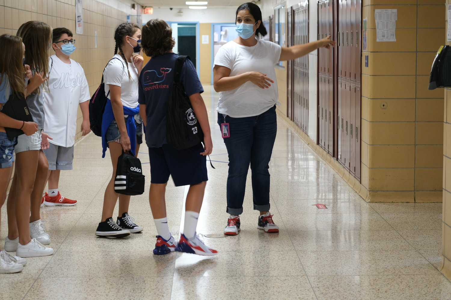 Christina Castilla-Lyson led a tour of seventh grade students at Oceanside Middle School on the first day back Sept. 8.