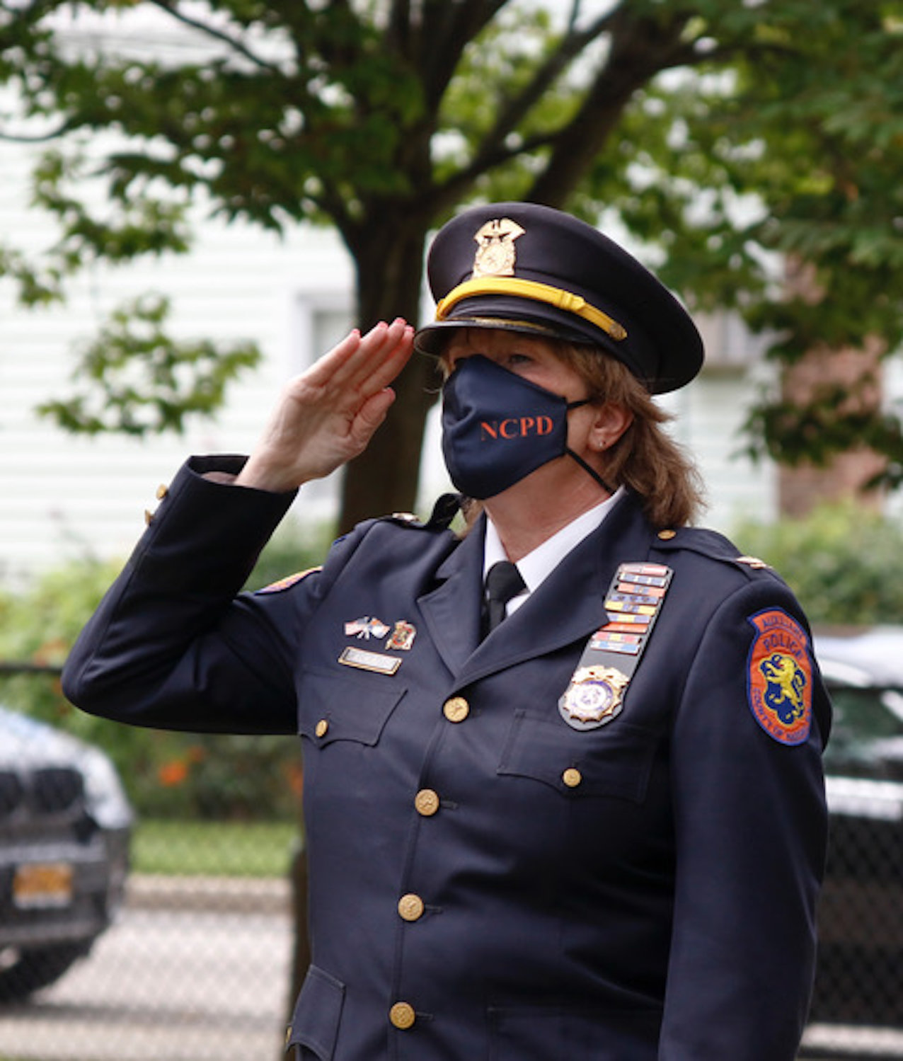 Nassau County Police Department Auxiliary Inspector Diane Laukaitis saluted.