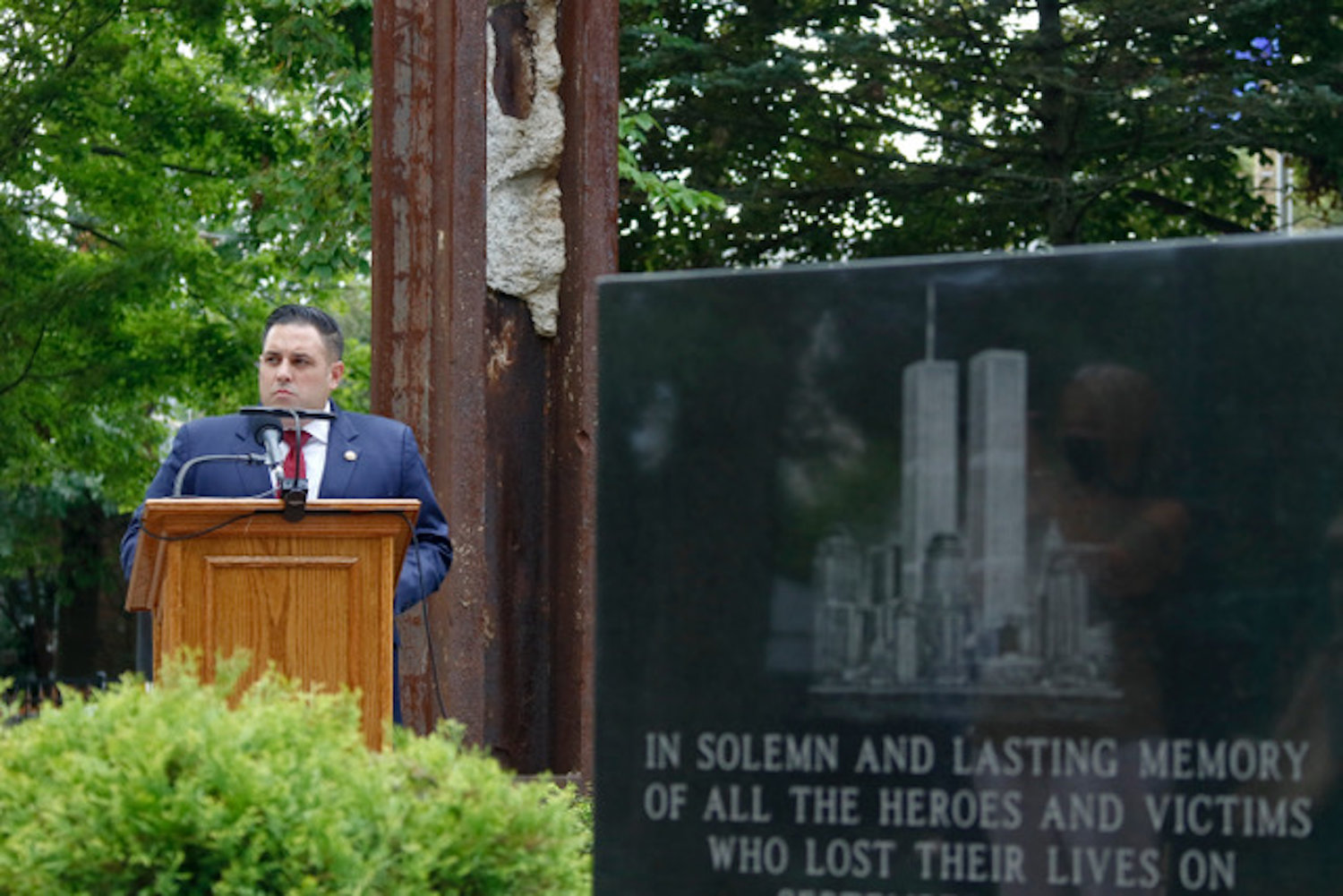 Hempstead Town Councilman Anthony D'Esposito read the names of those who died in the attacks.