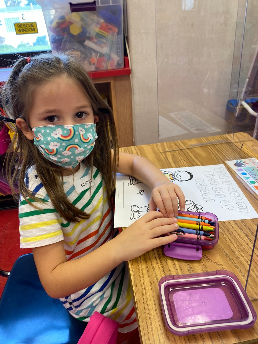 As schools returned last week, West End Elementary School first-grader Scarlett Pollin completed a first-day worksheet.