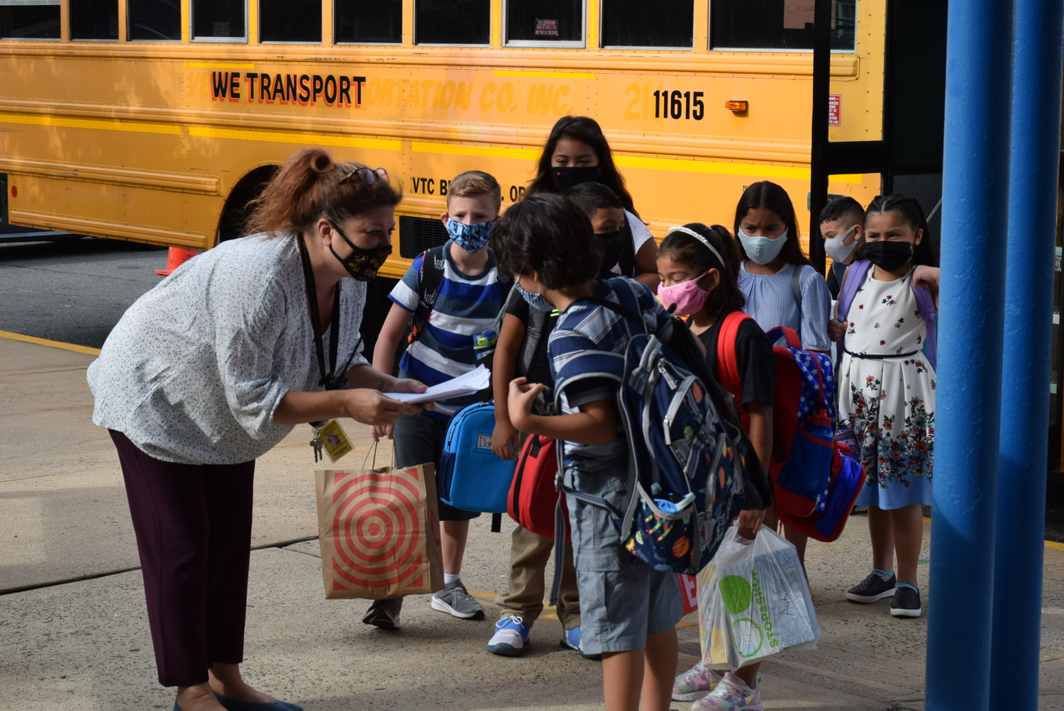 Cornwell Avenue School Principal Deanna Sinito checked students in for their first day of school.