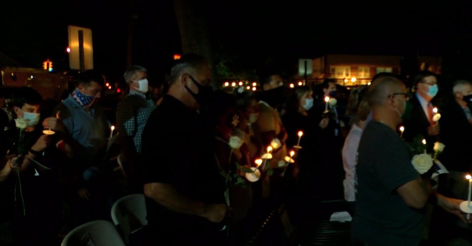 Residents held candles as part of the ceremony.