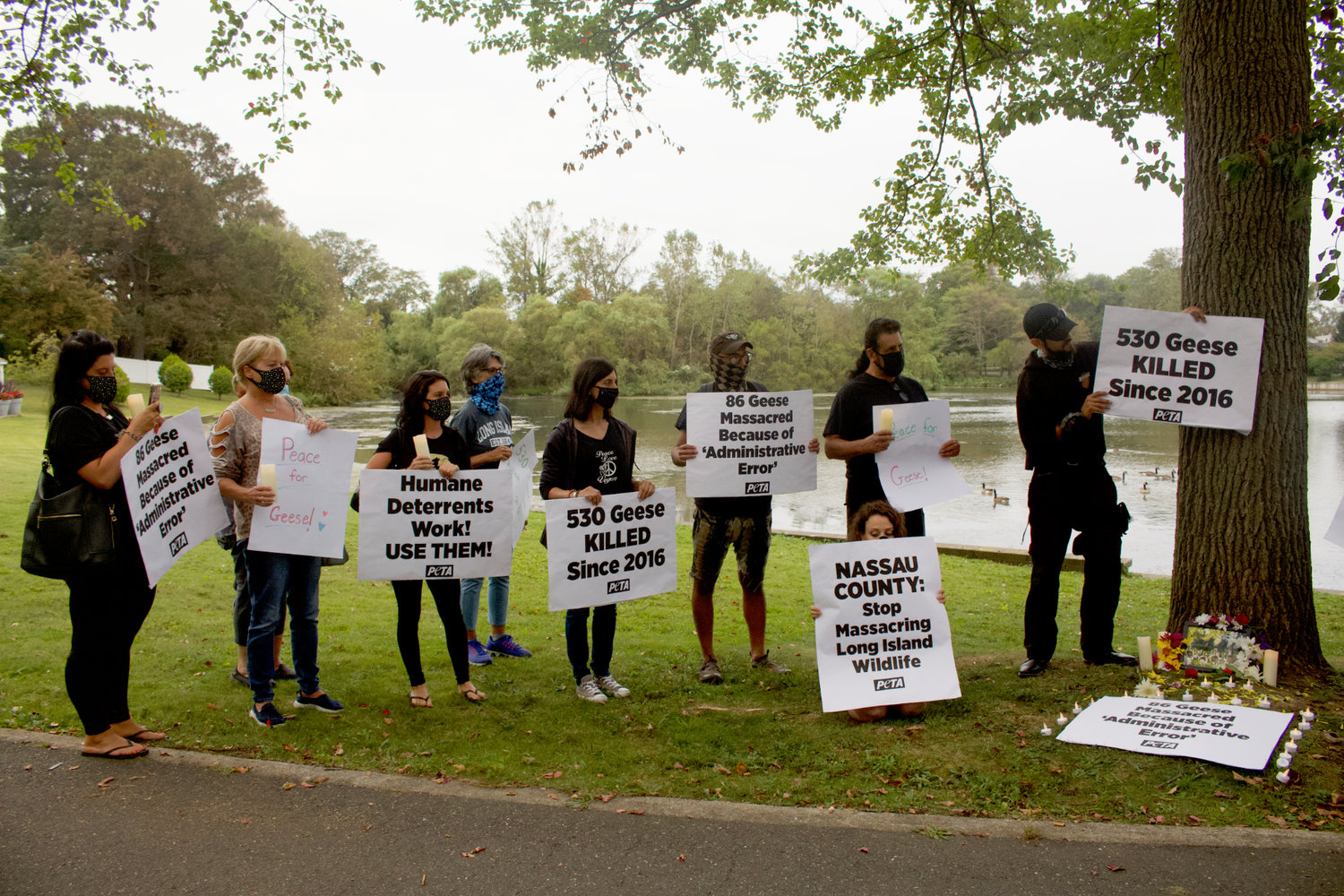 Dozens of local residents and animal rights activists gathered in Milburn Pond Park in Baldwin on Sept. 9 for a vigil to pay tribute to the 86 Canada geese that were removed by a federal agency, in error, in June and later killed.