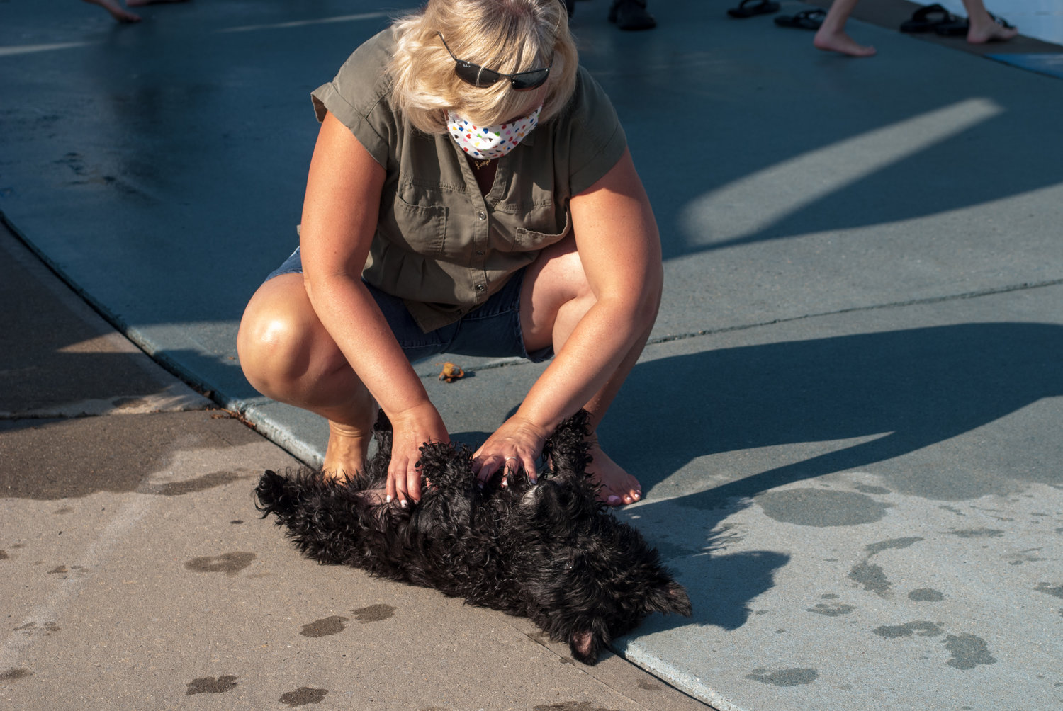 Jennifer Grande gave belly rubs to her 11 year-old Scottish terrier, Maggie.