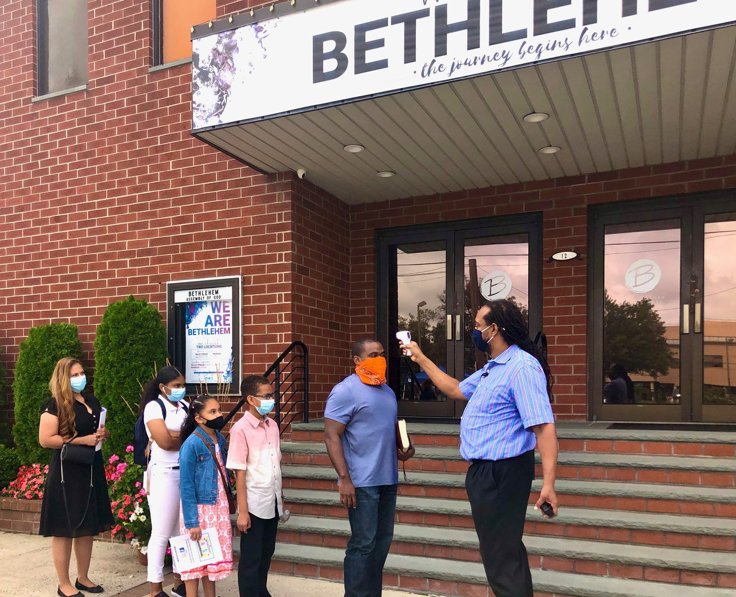 Temperatures are taken before entering services at the Bethlehem Assembly of God church in Valley Stream.