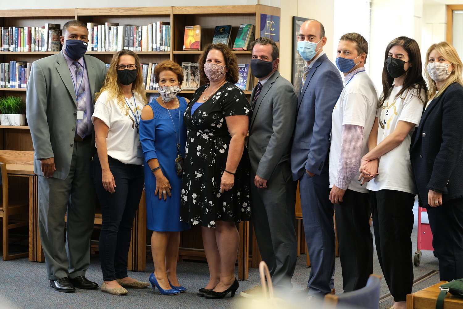Wolfe, fourth from the left, joined with her colleagues in the high school library on Sept. 14 to celebrate as the state Board of Regents announced the award at a virtual meeting.