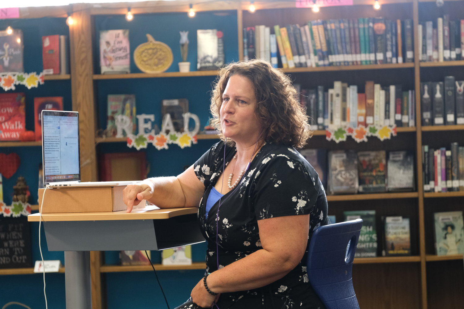 Oceanside High School social studies teacher Jennifer Wolfe accepted the award and gave remarks during the meeting.