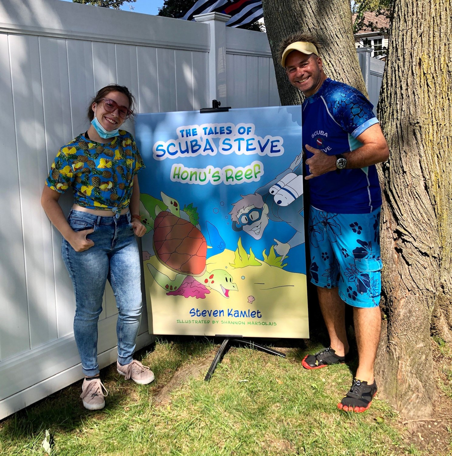 "North Merrick resident Steven Kamlet, right, has written a children's chapter book called ""The Tales of Scuba Steve,"" with illustrations by East Meadow High School student Shannon Marsolais."