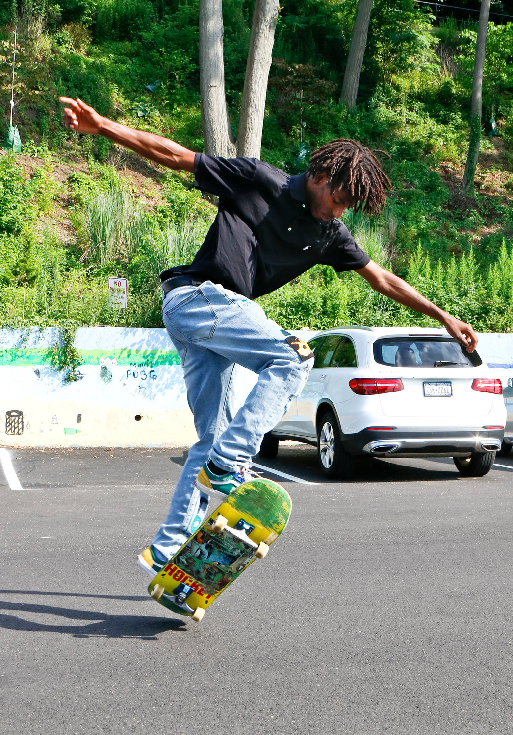 Skateboarder Cameron Williams, of Glen Cove, could be seen doing tricks by Sea Cliff Beach over the summer.