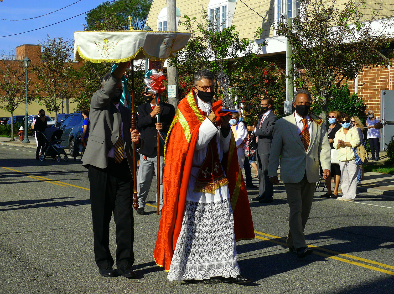 Monsignor  John Tutone led the parade.