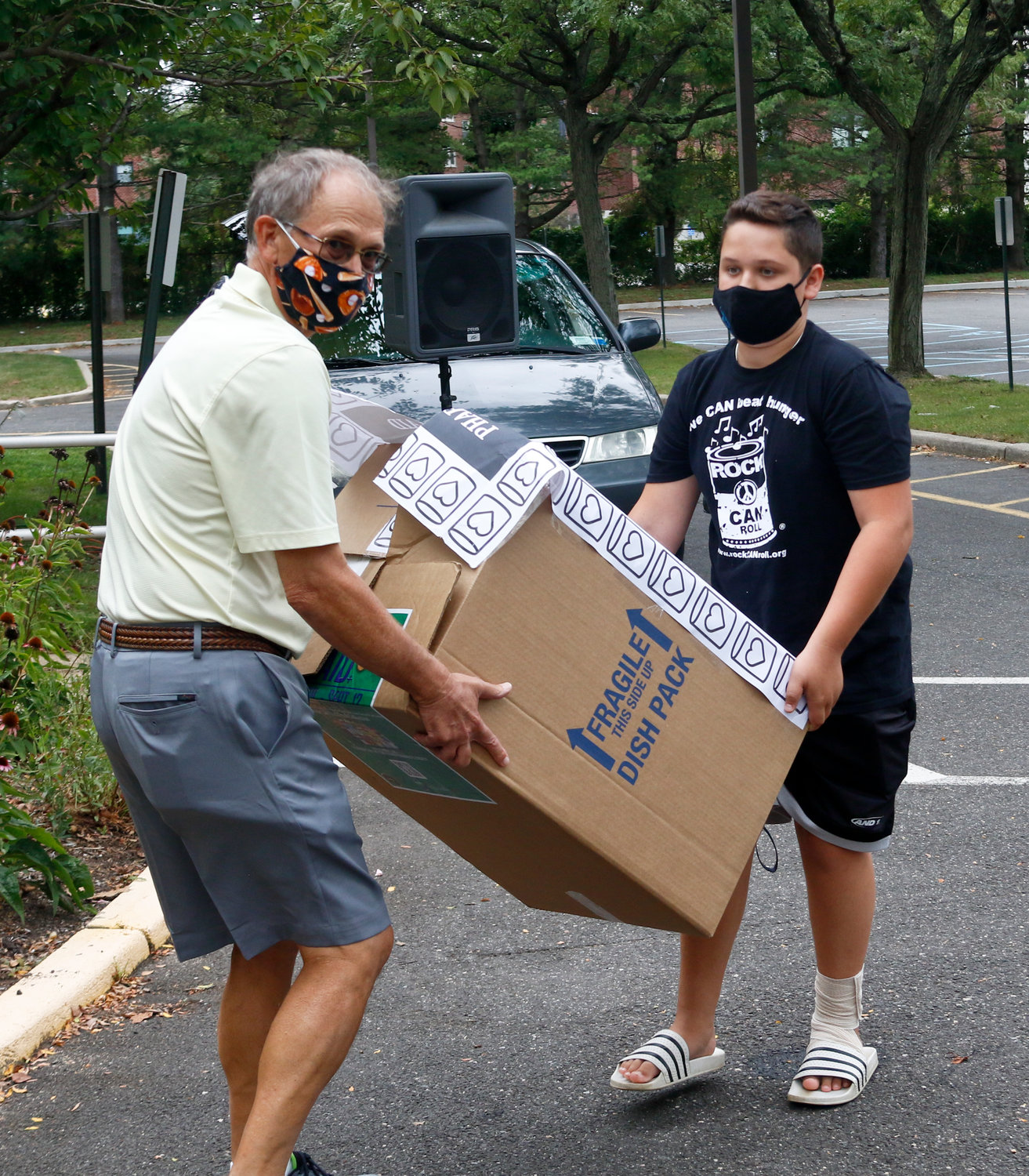 Boxes full of food and supplies were dropped off at Ryan Medical Pharmacy. Peter Weinstein and Oliver Hazen, a ninth-grader from Locust Valley, carried a donation to the sorting station.