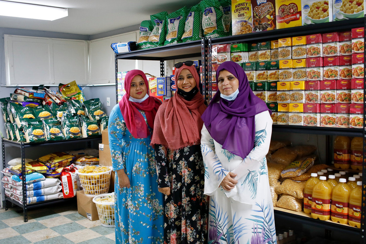 Masjid Hamza recently opened a food pantry in partnership with the Islamic Circle of North America. Shumaila Noor, far left, Ruhee Kapadia and Noshi Ahmed helped make it possible.