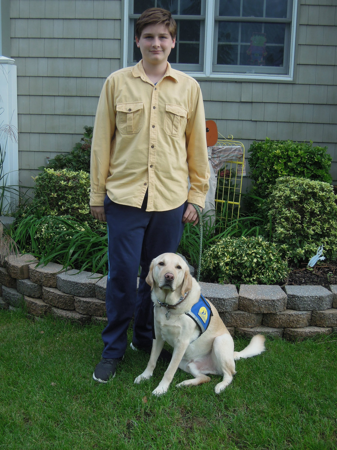 Tordy, with his service dog Draagon, raised more than $5,000 last year for Canine Companions for Independence.