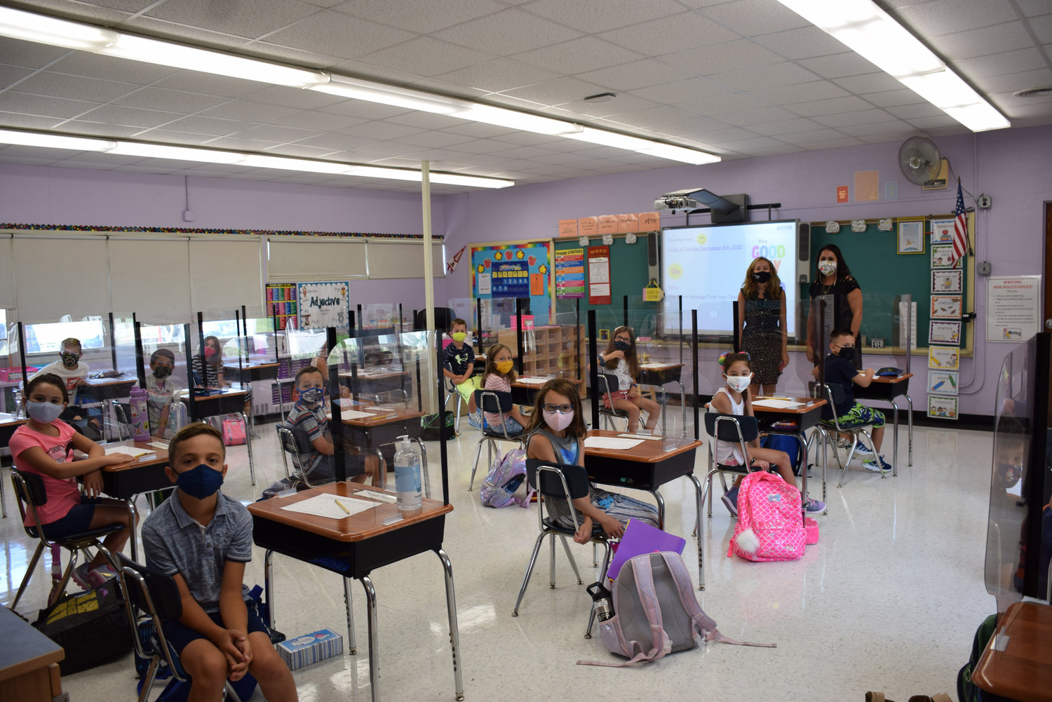 Mandalay Elementary School teacher, left, Stacy Wright, with Principal Marie Pisicchio and her third grade class on opening day.