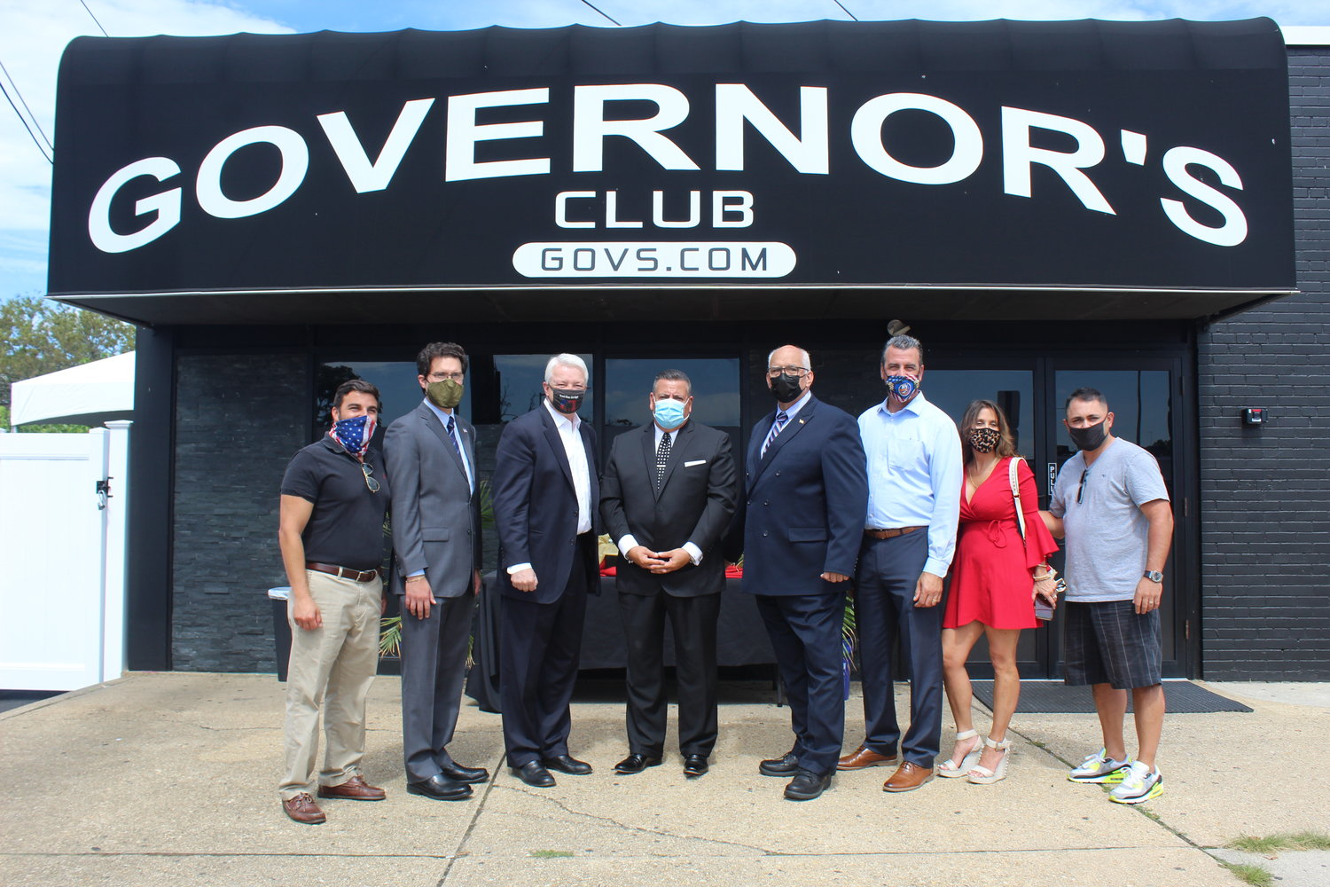 Local elected officials joined comedy club owner James Dolce, center, outside Governor's of Levittown last Thursday to call on Gov. Andrew Cuomo to reopen the venues for laughs.