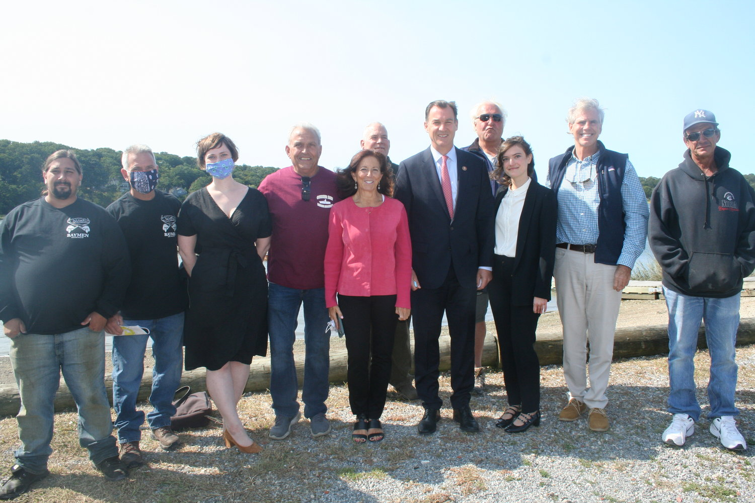 U.S. Rep. Tom Suozzi, fifth from right, and a number of environmental activists called for the Army Corps of Engineers to review Frank M. Flower & Sons' right to harvest shellfish using hydraulic dredging in Oyster Bay Harbor.