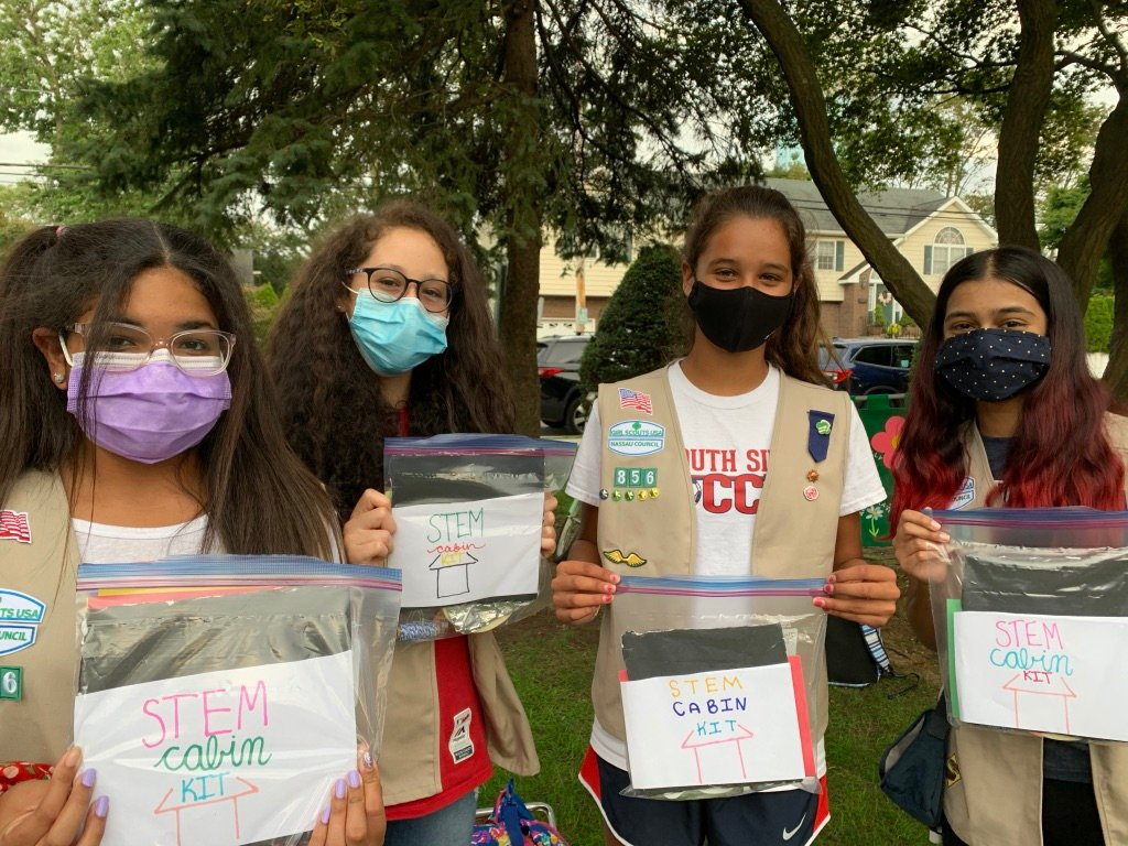 Girl Scouts Jazzelle Tolson, Emma Penninipede, Ella Santos and Nazneen Hassan all participated in the project at the Village Green.