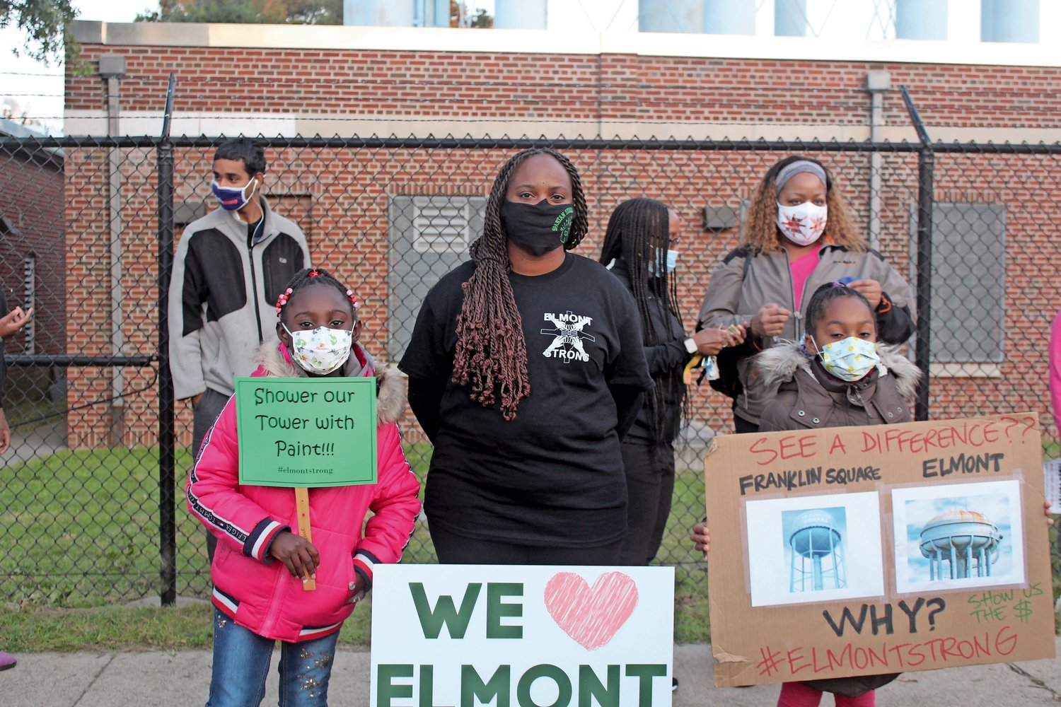 Victoria, Vernell and Desiree Nelson attended the water tower protest on Sept. 21.