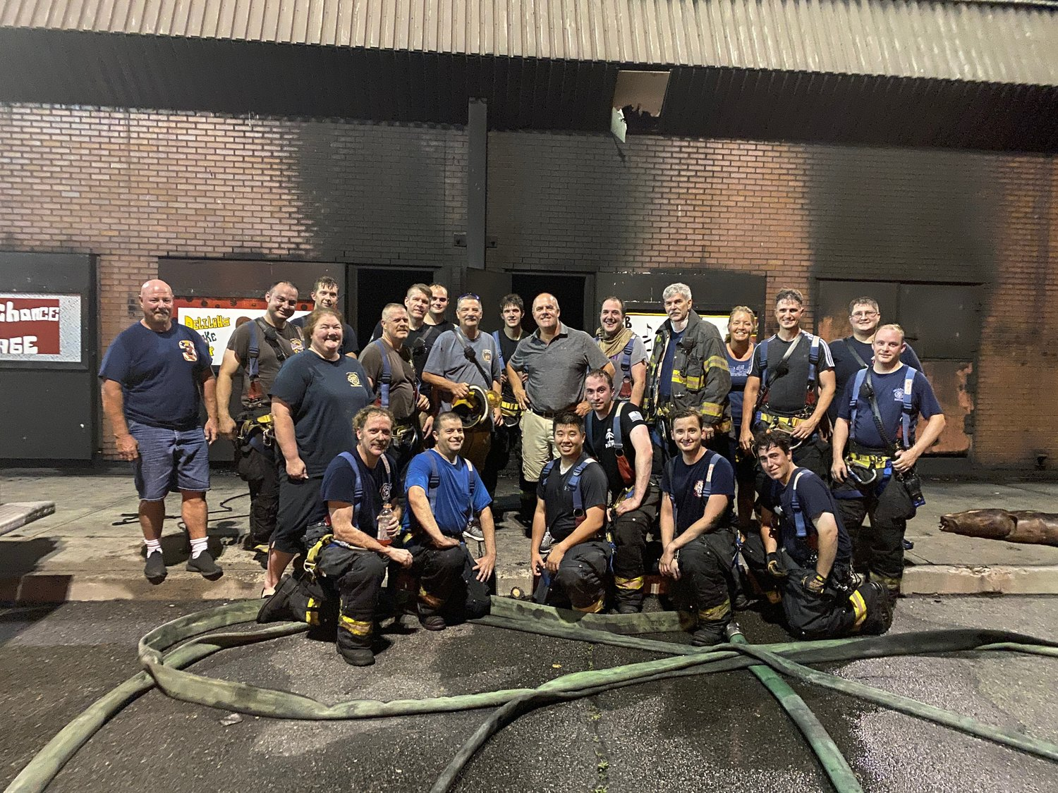 Bob Taylor, standing at center, joined with other members of the Bellmore Fire Department at the Fire Service Academy this summer.