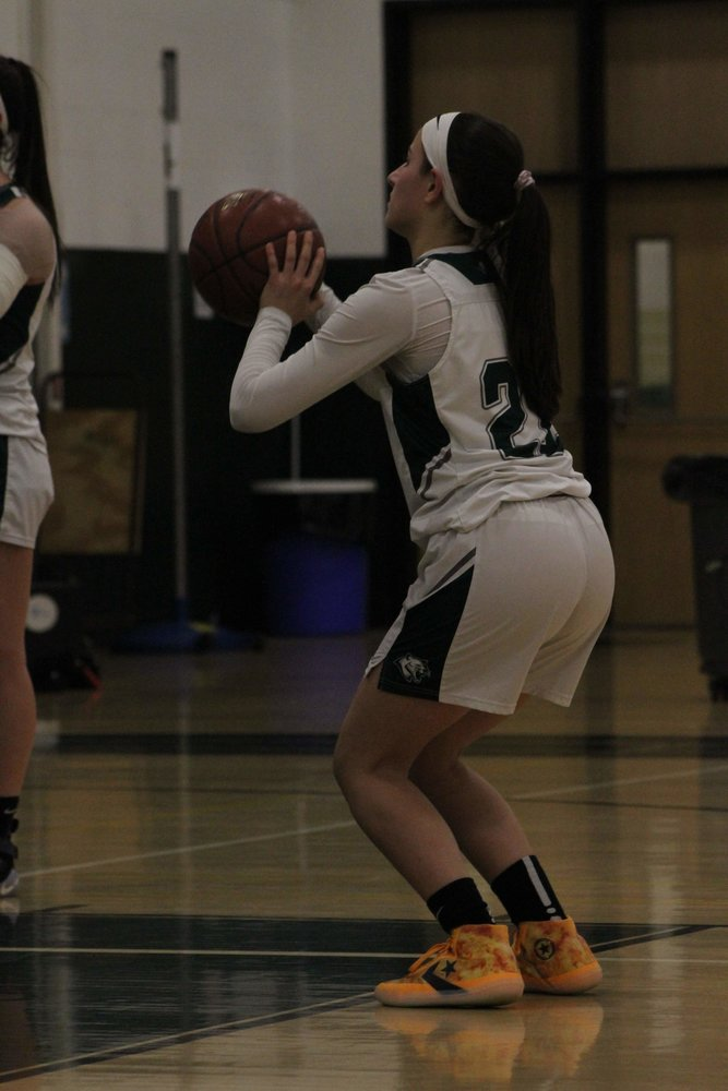 Nossen prepared to shoot from the foul line at a playoff game earlier this year. The 17-year-old has played varsity basketball since freshman year, and believes female athletes deserve as much praise and attention as male athletes.