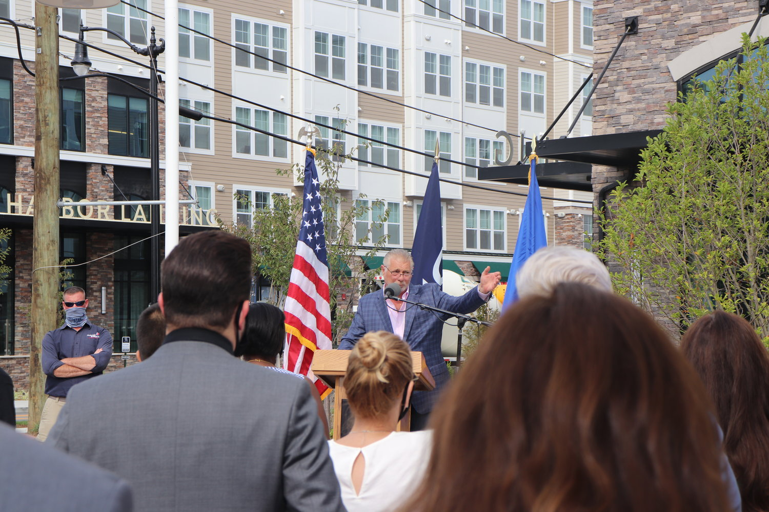 RXR Realty's Executive Vice President of Residential Development and Construction, Joe Graziose, reminisces on the progress made on the Garvies Point property in front of the attendees at the Harbor Landing ribbon cutting.