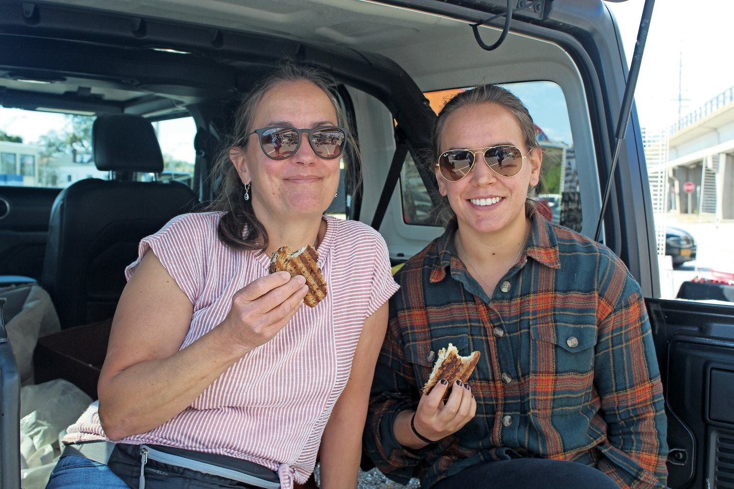Garden City residents Giule, left, and Angelina Fortino, brought homemade panini sandwiches to the pop-up market.
