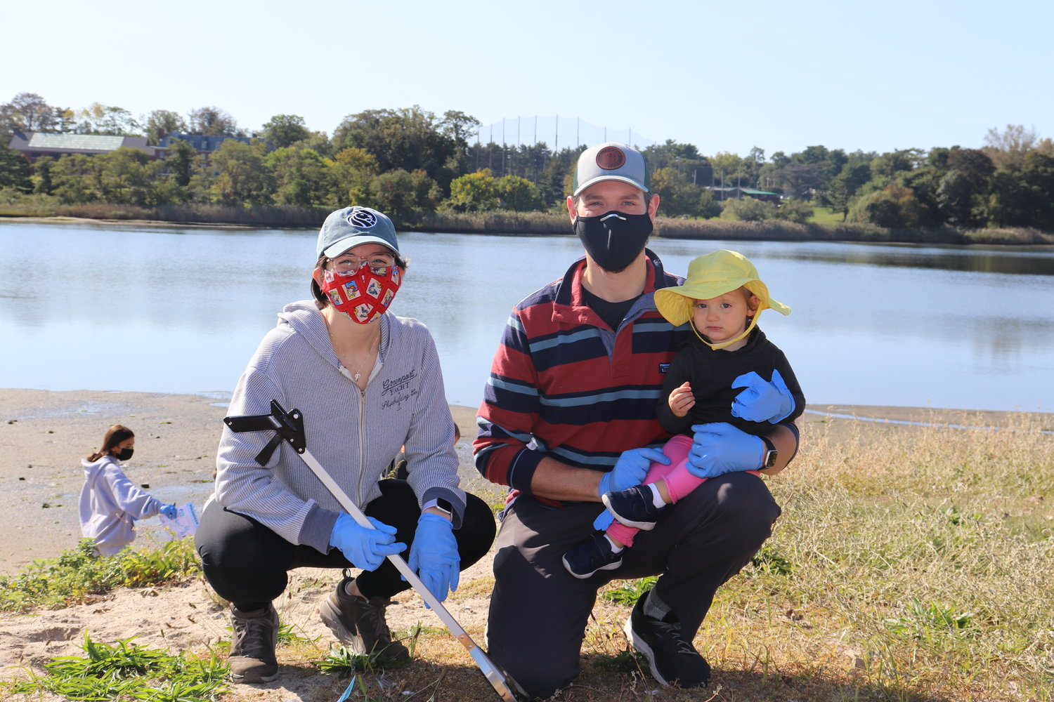 The cleanup was a family affair for Ann and Bryce Klatsky, who brought their child, C.J., along last Saturday.