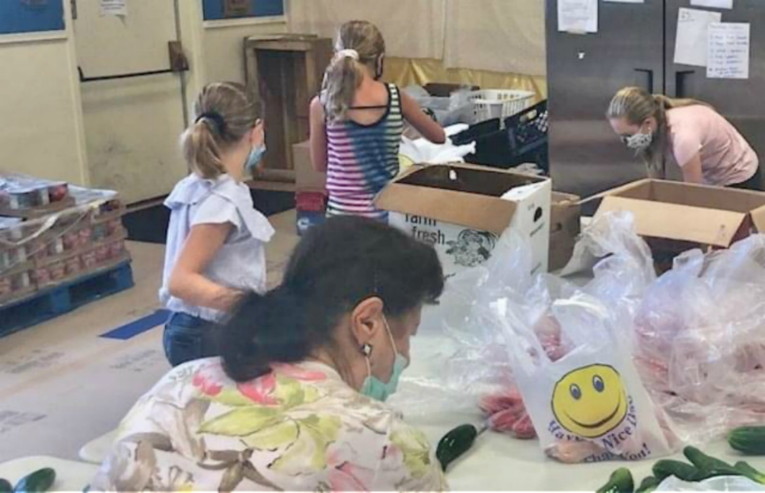 This past Labor Day, people of all ages volunteered at St. Rocco to help NOSH.