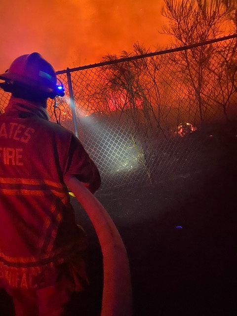 Firefighters tried toworked through a fire that melted fences.
