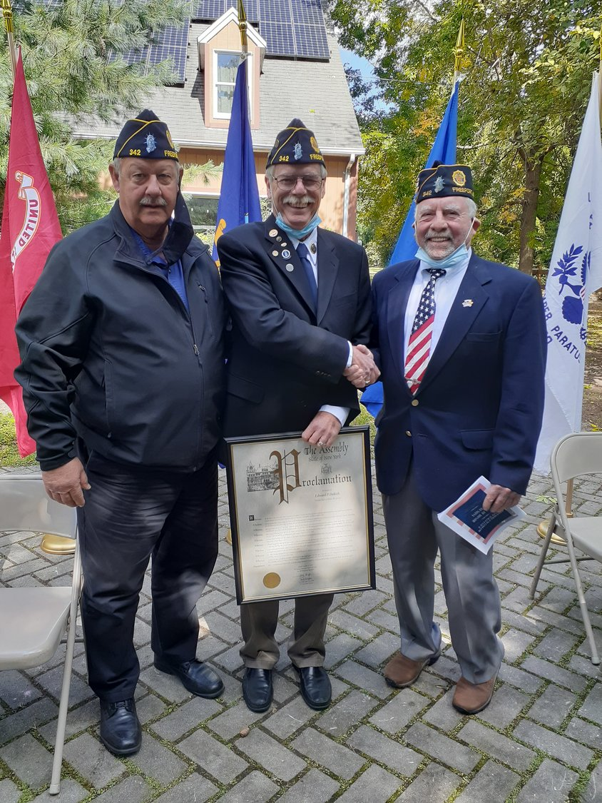 Freeporter Edward Dukich, center, was honored at the Veterans Hall of Honor ceremony. Mayor Robert Kennedy, left, and William Clinton Story Post No. 342 Commander Ed Martin Jr. congratulated their fellow post member.