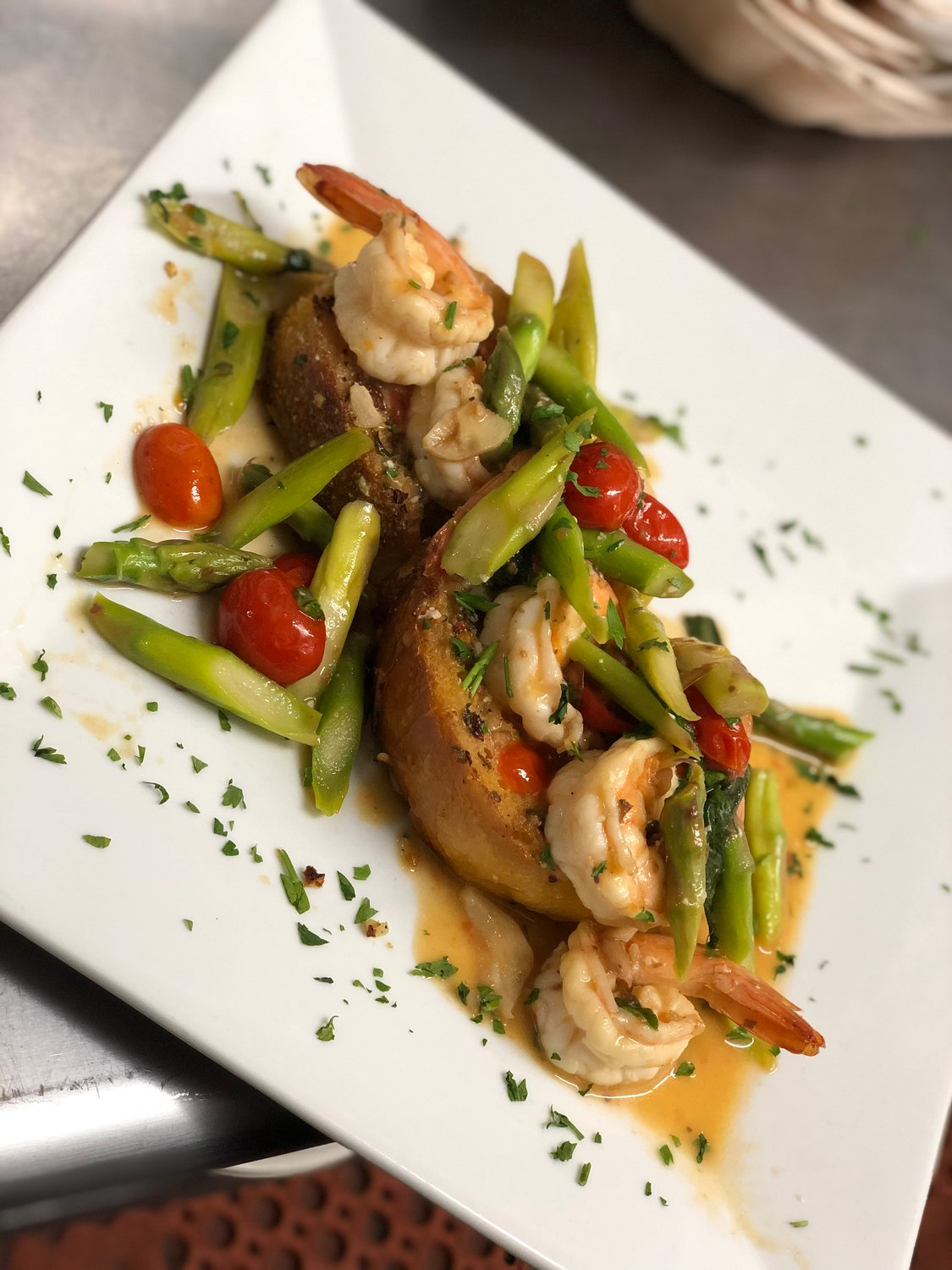 The Italian-American menu features healthier options, as well, including sautéed shrimp and vegetables, pictured, gluten-free pasta and zucchini linguine noodles.