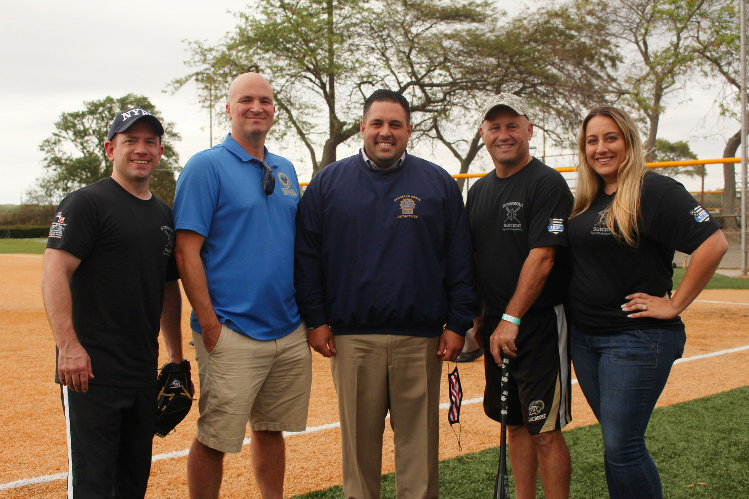 Beyond the Badge NY co-founder Chris Panetta, far left, Hempstead town councilman and former Port Authority officer Christopher Carini, Town Councilman Anthony D'Esposito, Nassau County Police Commissioner Patrick Ryder and Michelle Panetta.