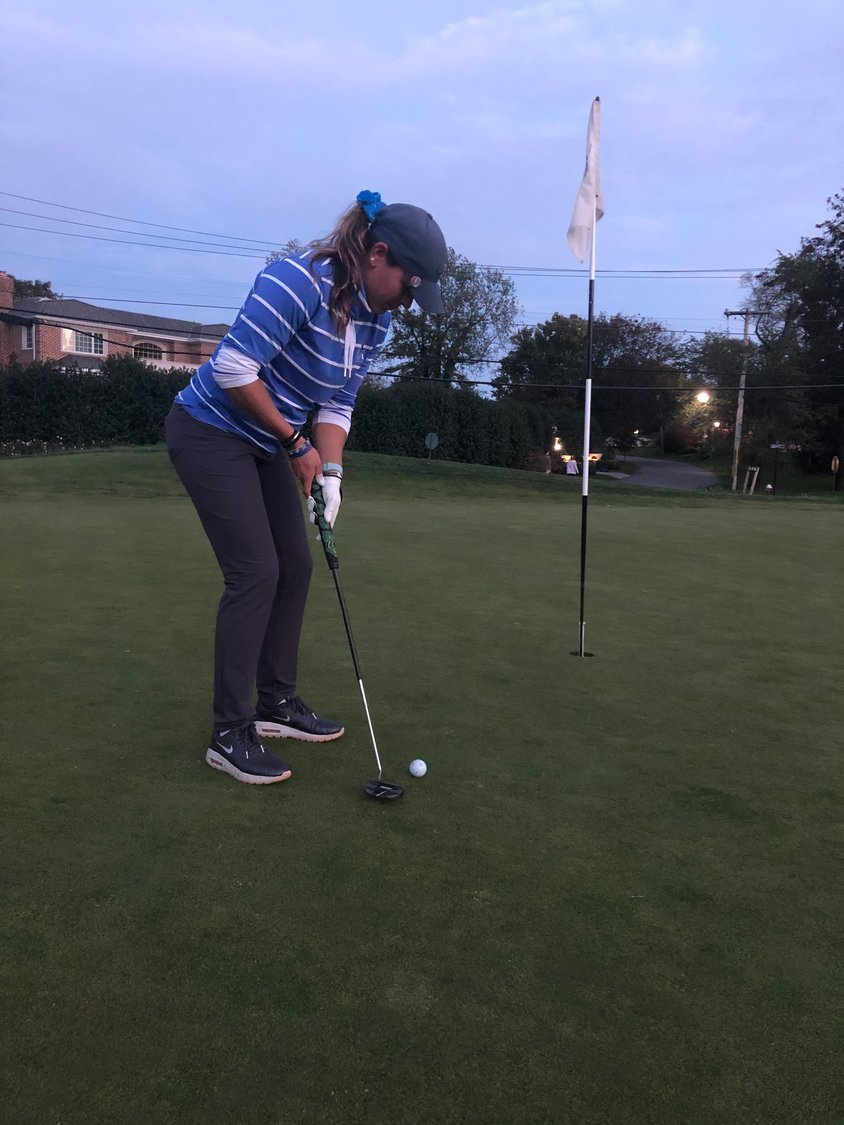 Cedarhurst resident Kacie Mulligan, the assistant golf pro at the Lawrence Yacht & Country Club shot her last putt during her golfing marathon fundraiser.