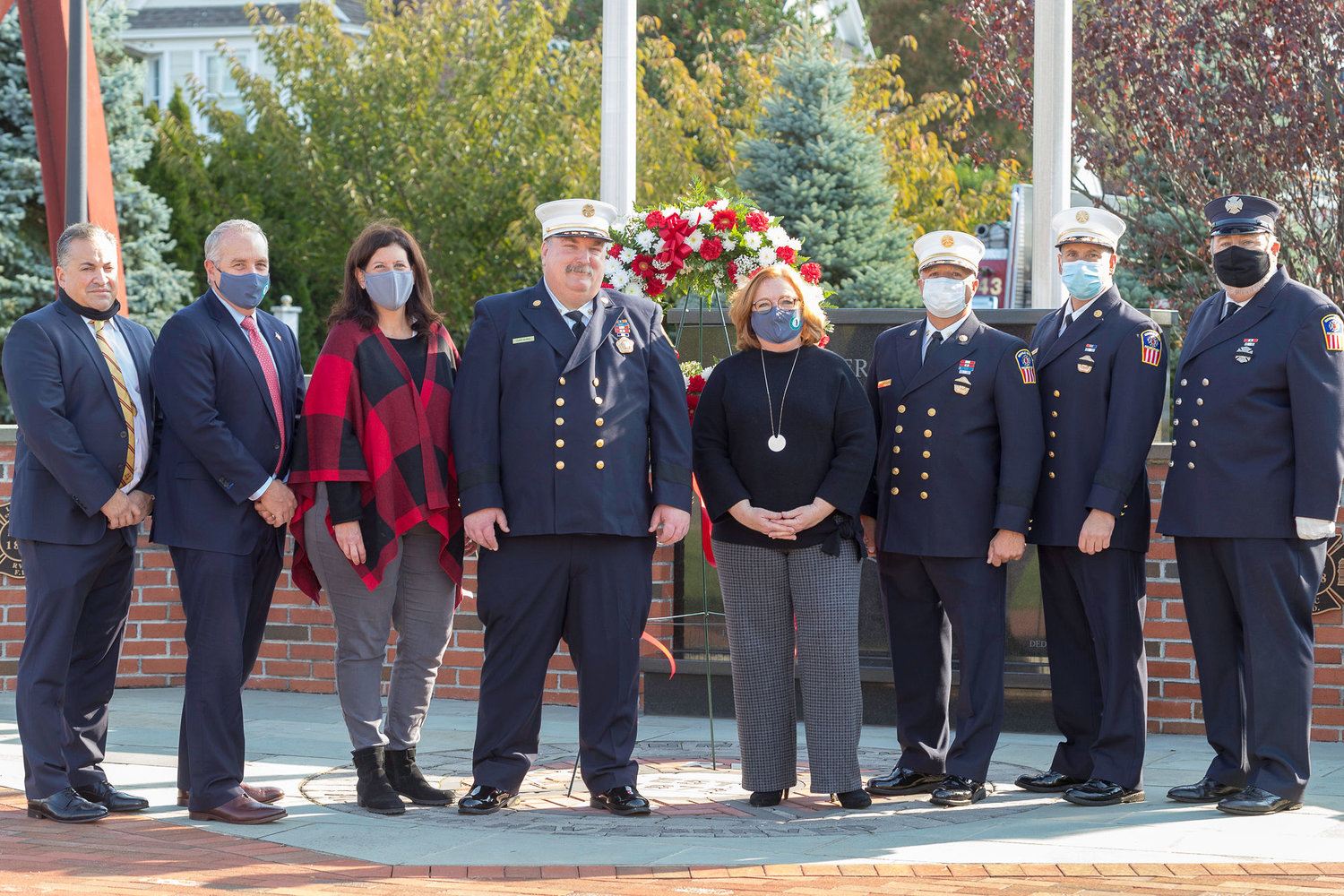 Rockville Centre Fire Chief Eric Burel, fourth from left, with Trustee Emilio Grillo, Trustee Michael Sepe, Deputy Mayor Kathy Baxley, Trustee Nancy Howard, First Assistant Chief James Avondet, Second Assistant Chief Scott Mohr, and Mayor Francis X. Murray.