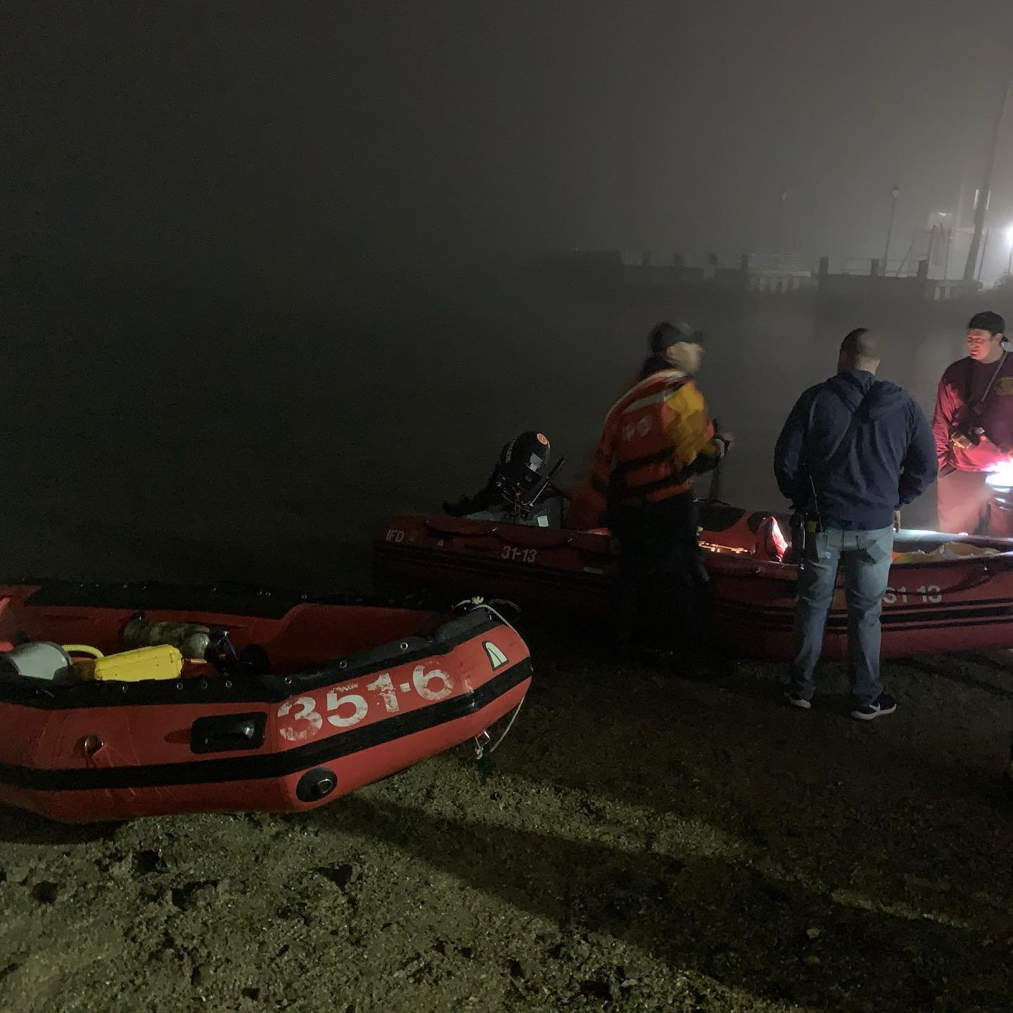 First responders from the Lawrence-Cedarhurst Fire Department prepare to rescue two jet skiers near Broswere Bay in Woodmere on Oct. 20