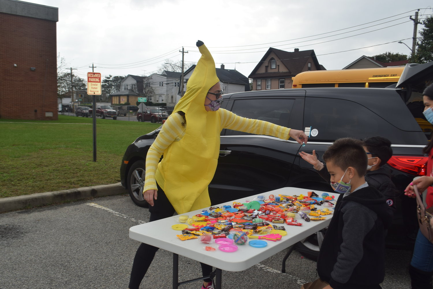 Rachel Tiran dressed as a banana and distributed candy from her 'ghost graveyard.'