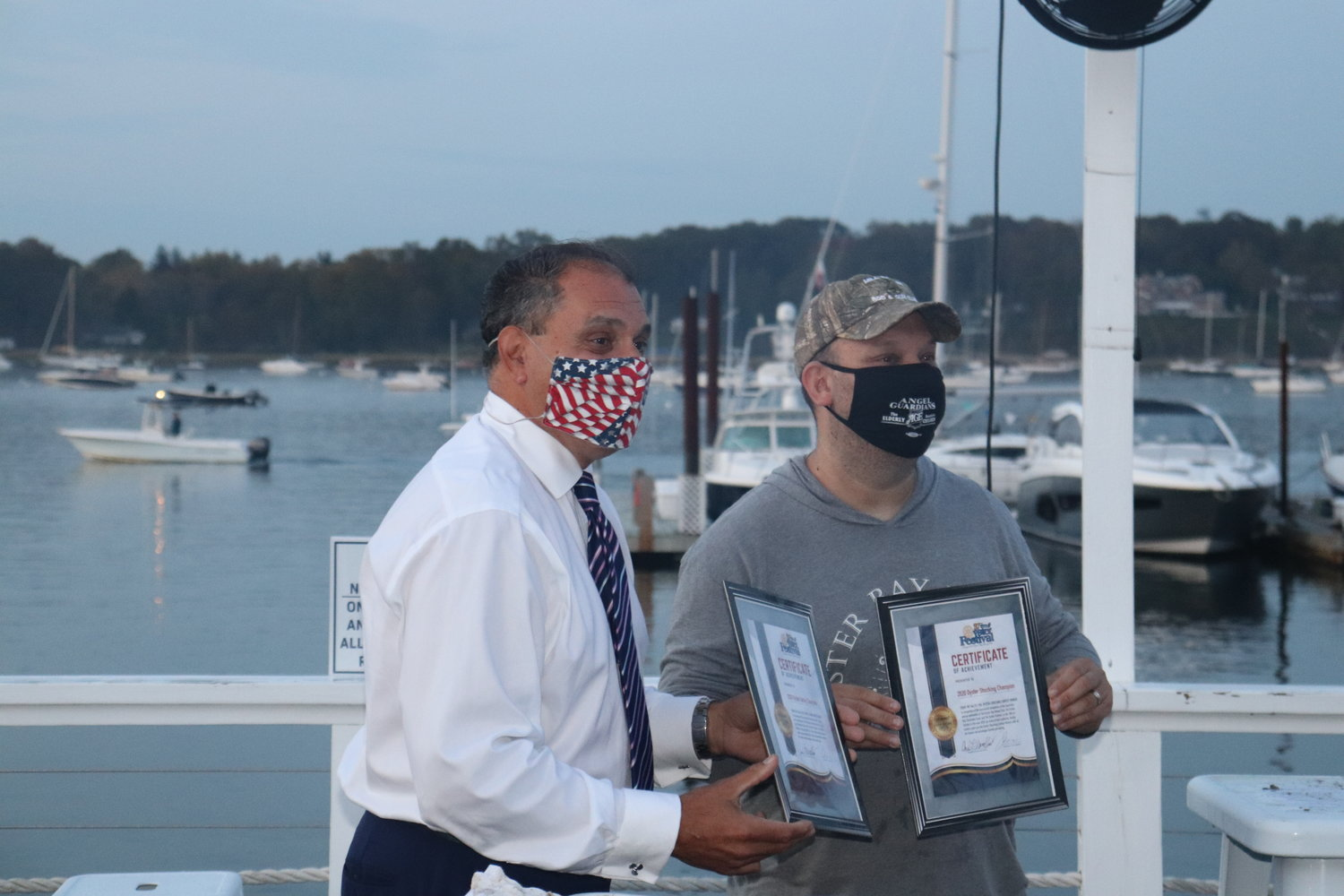 Supervisor Joseph Saladino, left, was the winner of the Oyster-Eating Contest and Oyster Bay resident Brad Launer, the winner of the Oyster-Shucking Contest.