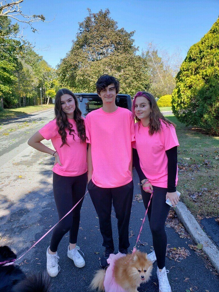 Triplets Jesee, James and Jenee Sarisky walked their dogs in the Maurer Foundation's inaugural Pink Ribbon Walk/Run, a virtual event to raise money for the organization.