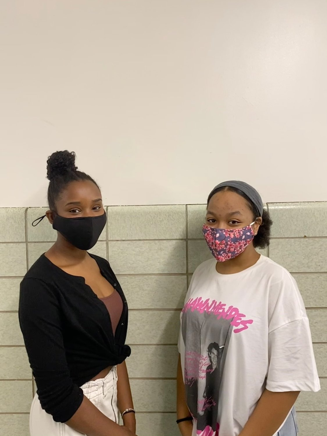 Eden Gould-Anderson, left, and Joan Mesy, seniors at Sanford H. Calhoun High School, started the Racial Equity Club to share their perspectives as students of color.