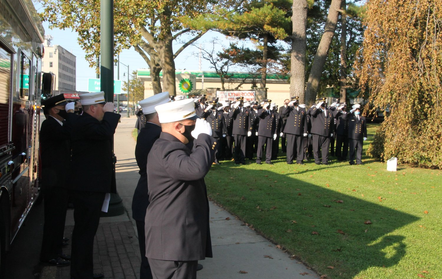 The firefighters saluted the memorial.