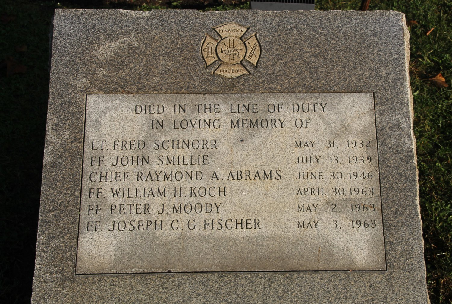 A stone marker on the site of the memorial has the late firefighters' names engraved.