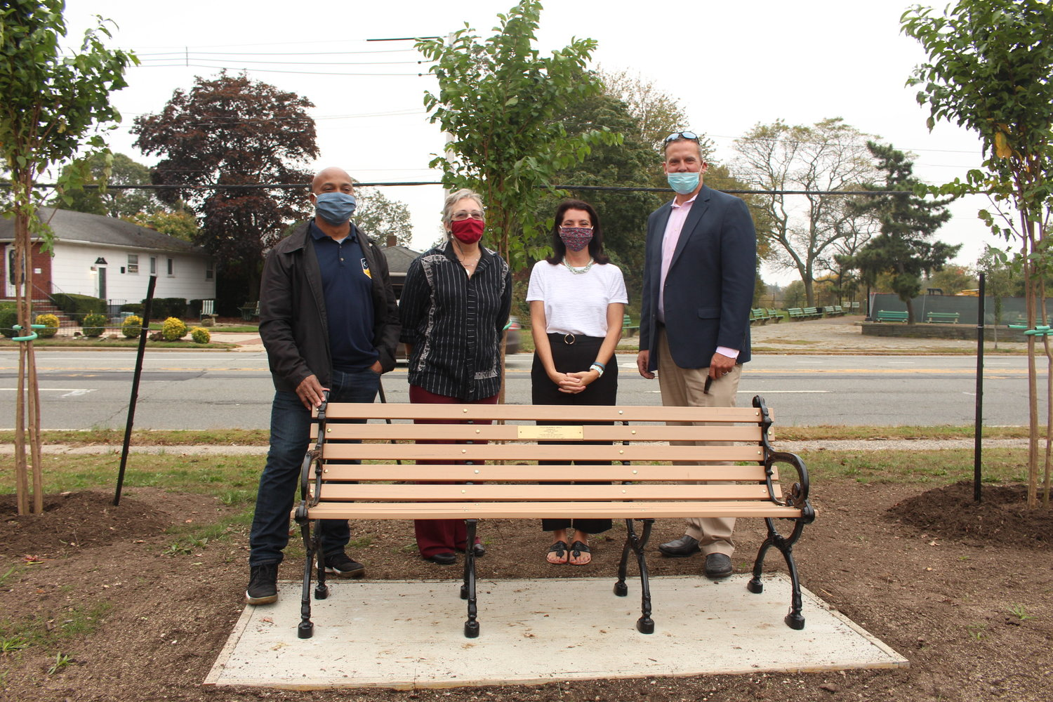 Baldwin Civic Association President Darien Ward, far left, joined civic association member Sara Hill, Jason Vitale's widow, Jennifer Vitale, and Baldwin Chamber of Commerce President Erik Mahler at the ceremony to dedicate Vitale Grove on Oct. 22.