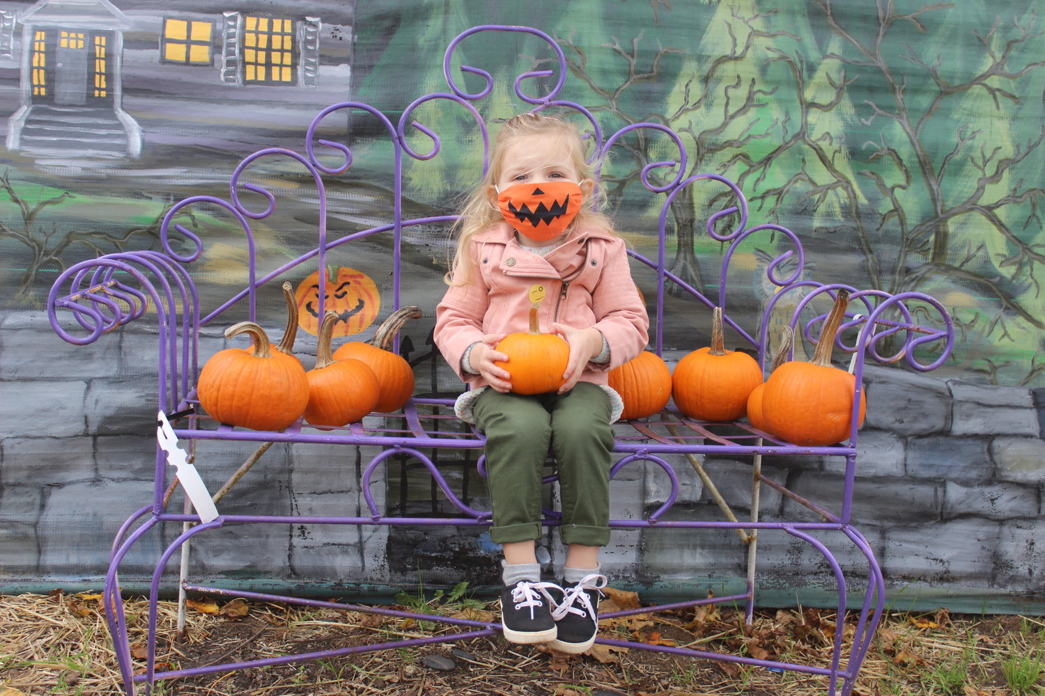 Madison Williams, 2, of East Meadow, was the pick of the pumpkin patch with her Halloween face mask last Sunday at Cipriano Nursery and Florist for its weekly pumpkin painting session.