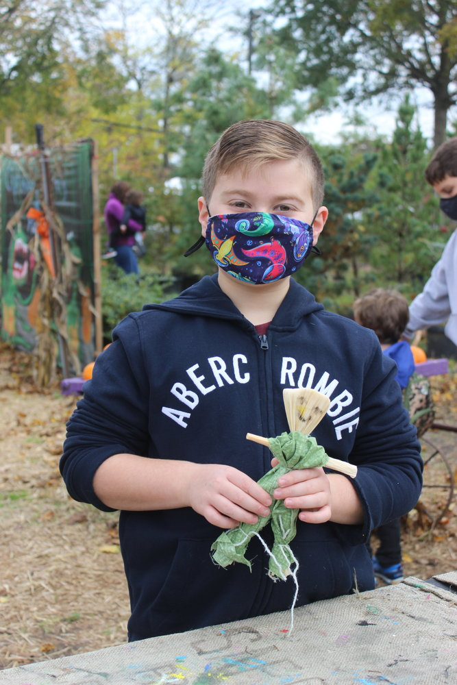 Daniel Ferrari, 11, of East Meadow, got an early start on November's weekly craft: corn husk dolls.
