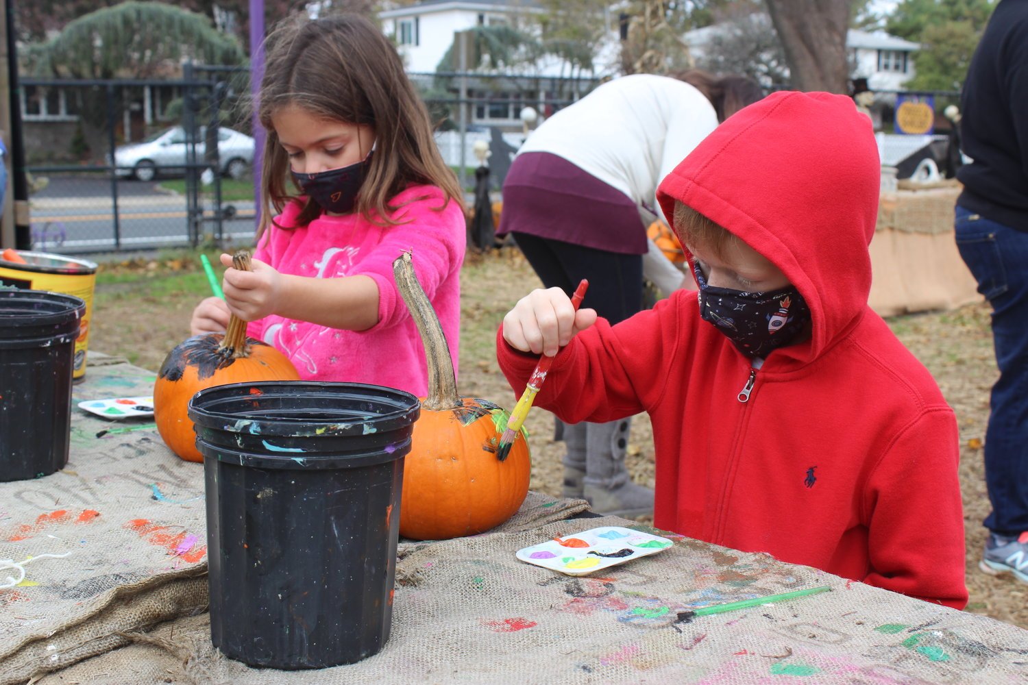 Liana Yodice, 6, and her little brother Anthony, 5, of East Meadow, got started on their pumpkins.