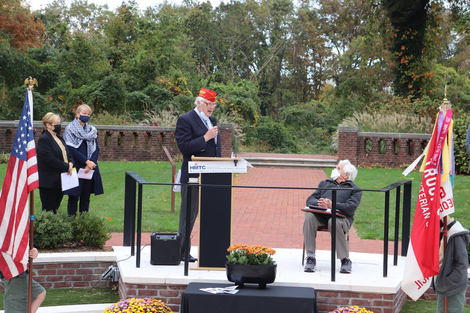 U.S. Army Maj. Fred Nielsen, left, recounts the first time meeting Robert Praver in the Children's Memorial Garden.