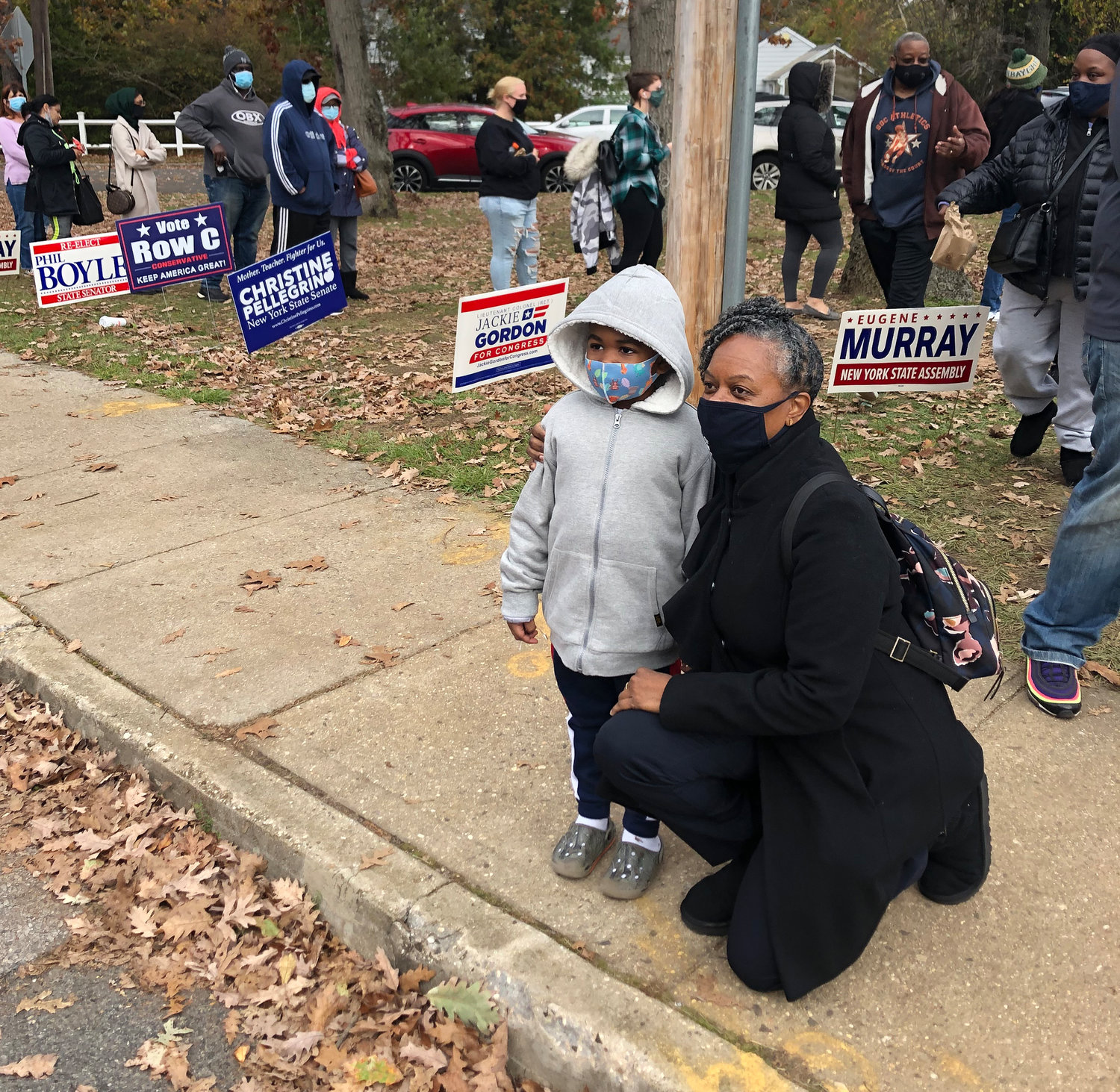 Jackie Gordon meeting with voters and their children in the lead-up to Election Day.