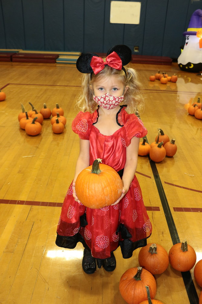 Kindergartener Cora Hamm, also known as Minnie Mouse, picked out the best pumpkin she could find.